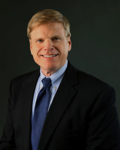Headshot of David Perrick, MD against dark background