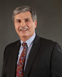 Headshot of Dr. Michael J. Bykowski, MD, PhD against gray background